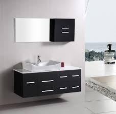 black cabinet side square mirror on plain wall closed single