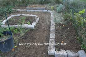 raised bed vegetable garden with stone borders growing the home
