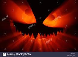 halloween jack o lantern monster light effects stock photo