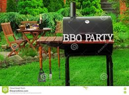 summer weekend bbq scene with charcoal grill on the backyard stock