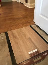 what color of vinyl plank flooring goes with honey oak cabinets using different color vinyl plank floor for bedrooms