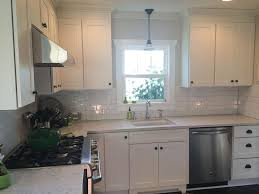 white shaker kitchen base cabinets seattle remodeled kitchen has beadboard ceiling white