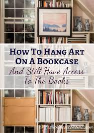 Hangart by How To Hang Art On A Bookcase And Still Have Easy Access To The