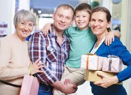 happy family holding presents photo free