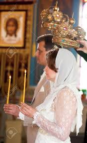 orthodox wedding crowns and groom during orthodox wedding ceremony with candles