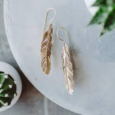 gold feather earrings feather earrings yobel market