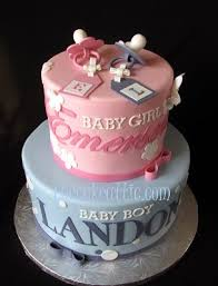 pink and blue baby shower cakes for twins with pacifiers the