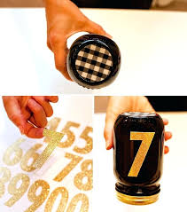 black and gold centerpieces black and gold centerpieces diy race jars black gold