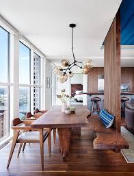 alterstudio architecture transforms a bland condominium stilnovo s stige pendant illuminates the dining area in an austin texas condo overlooking lady
