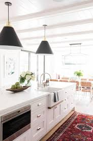 best 25 sink in island ideas on pinterest kitchen island sink modern farmhouse meets the hamptons in studio mcgee s latest remodel vintage kitchen rug