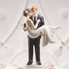 christian wedding cake toppers christian wedding toppers swept up in his arms wedding cake