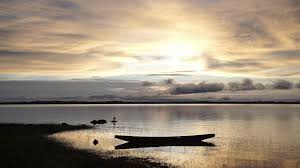 tranquility magnificent sunrise on an african lake a canoe is moored to the