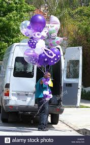 balloons delivered osbourne has balloons delivered to his house to celebrate stock