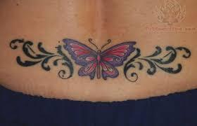 beautiful butterfly and tribal on lowerback beautiful