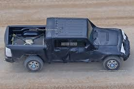 camo jeep yj jeep wrangler pickup spotted for the first time motor trend