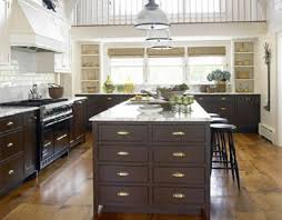 kitchen with brown cabinets and golden knobs selecting the right
