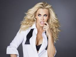 jenny mccarthy is wearing her long hair half up and half down her