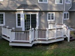 white railing with top railing and flooring same color and the