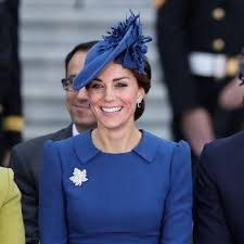 kate middleton wore a blue jenny packham dress as she arrived in