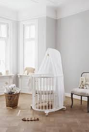 beautiful oval shaped scandinavian designed white crib stokke