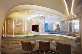 ek home interiors design helsinki modern curved mini bar area with brown bar stools and glaszed