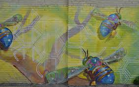 alleyway of dreams as i walk toronto part of a large mural on a wall in a lane three very big bees