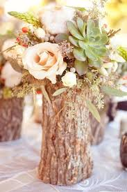 Vases For Centerpieces For Weddings Tree Stump U201cvases U201d Filled With Flowers As Your Fall Wedding