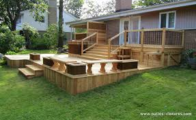 two level red cedar deck with a bistro corner on the top level and