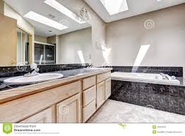 bathroom with granite tile trim and skylight stock photo image