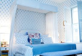 white curtain with wall and green bed also floor blue red carpet
