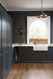 wood countertops dark grey kitchen cabinets lighting flooring sink