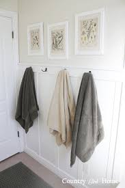 country home board and batten bathroom wall with towel hooks