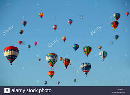 view of air balloons against blue sky balloon festival stock
