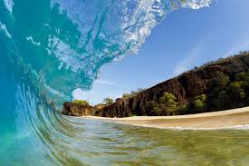 hawaii makena beach beautiful wave breaking along shore wall hawaii makena beach beautiful wave breaking along shore wall mural photo wallpaper
