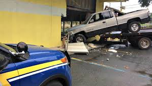Woman Loses Control Of Truck Drives Straight Into Carlos Furniture - Carlos furniture