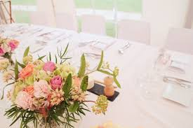 pink and green small floral arrangement on white dining table free