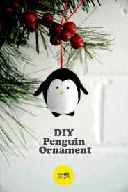 diy penguin ornament one black glove some felt and stuffing make