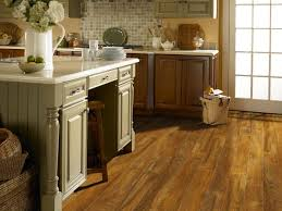 kitchen cabinets on top of floating floor laminate flooring for basements hgtv