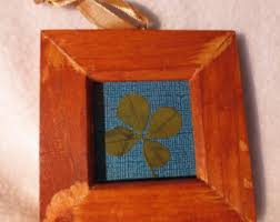 framed four leaf clover ornament from luckandbuttons on etsy studio