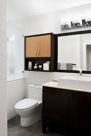 Over The Toilet Storage Cabinets Over The Toilet Bathroom Storage Cabinets With Modern Sconce