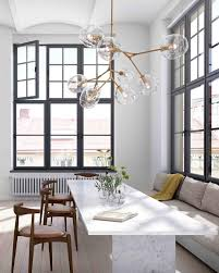 lighting floating bubble chandelier with white dining table also