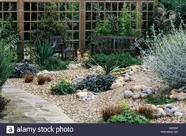 gravel garden path trellis bench drought tolerant plants pebbles