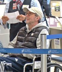 Drake In A Wheel Chair Wheelchair Bound Eric Clapton Looks Frail At Lax Daily Mail Online