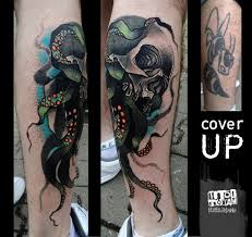 new style colored human skull with octopus legs tattoo