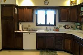 redo kitchen cabinets 15 diy kitchen cabinet makeovers before after photos of