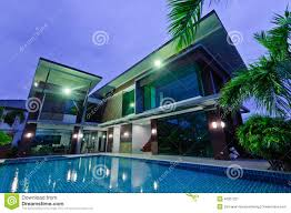 modern house with swimming pool at night download from over 49