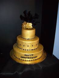 gold and black wedding cake brides request was a gold fondant