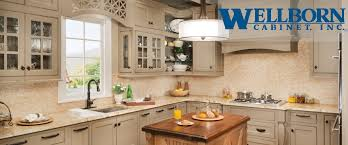 bathroom wheat wellborn cabinets with sink plus chandelier for