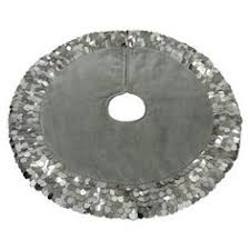 our luxurious silver brocade tree skirt is 66 inches in diameter
