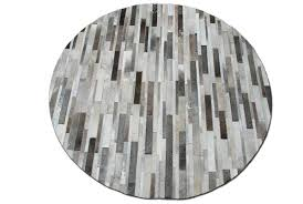 round taupe gray patchwork cowhide area rug in stripes design